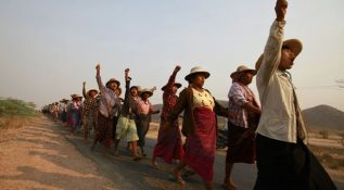 Villagers protest against a copper mine project during a visit by Myanmar pro-democracy leader Aung San Suu Kyi in Sarlingyi township